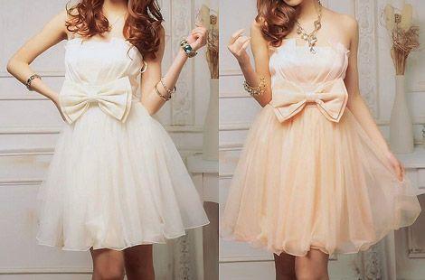 Випускні сукні з бантами